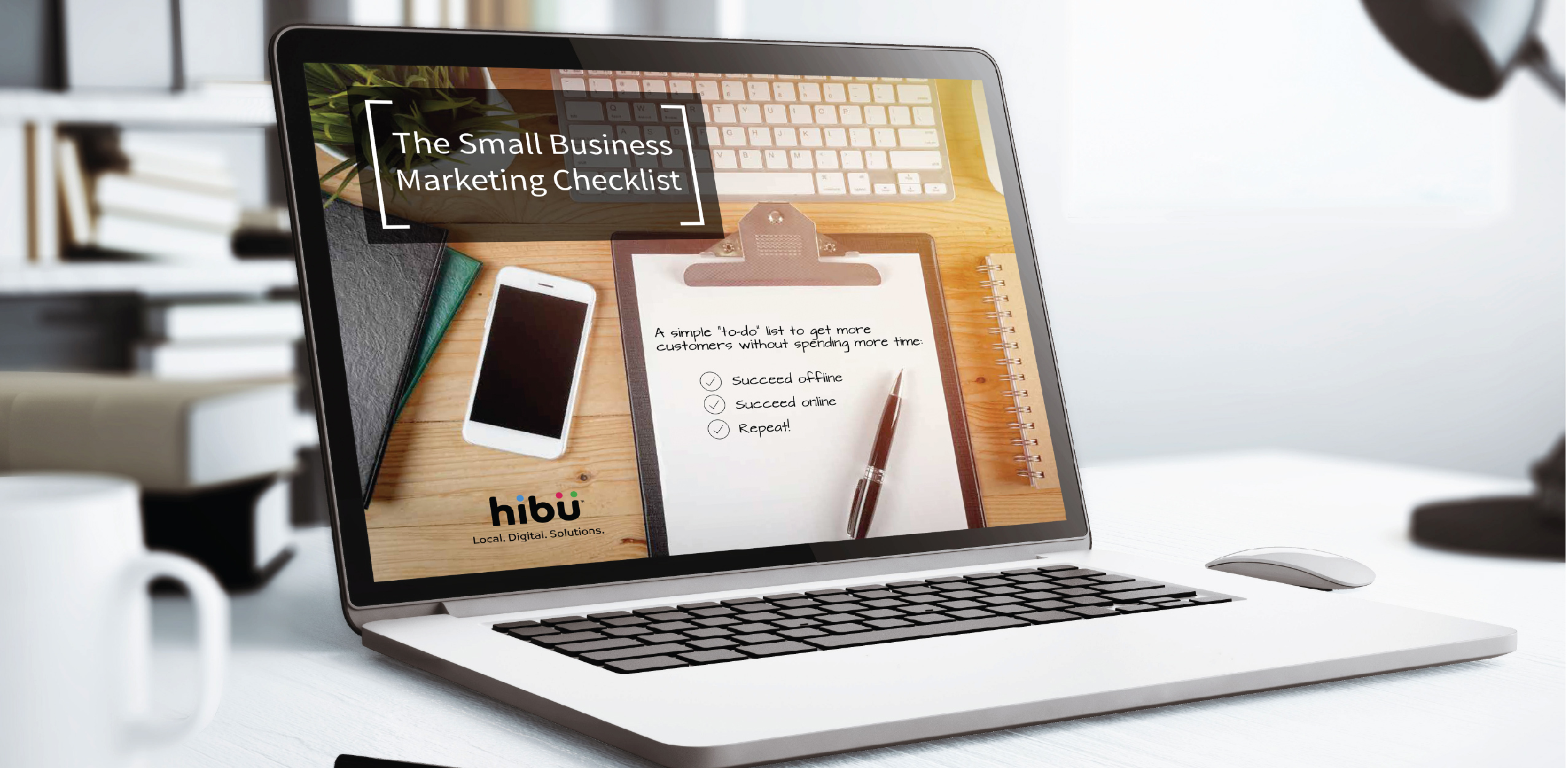 Hibu's Small Business Marketing Checklist on a laptop in an office