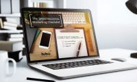 Hibu's Small Business Marketing Checklist on a laptop sitting on a desk