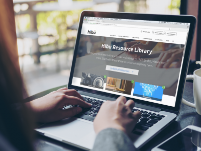 Hibu's Digital Marketing Resource Library on a laptop